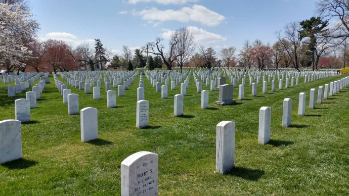 arlington national cemetery is beautiful and sobering all at the same time it is a sea of gravestones as far as you can see its incredible to think that